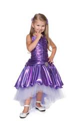 Little girl in a purple dres