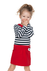 Little girl closes her mouth with her hands