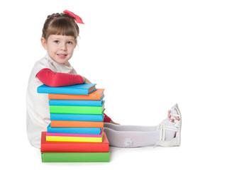 Little girl near books