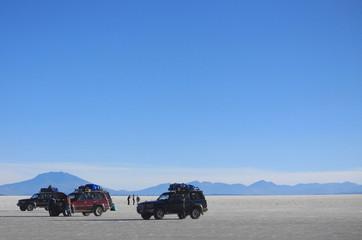 three cars with people in Salar de Uyuni