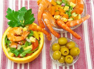 vegetable salad, shrimp and olives close-up