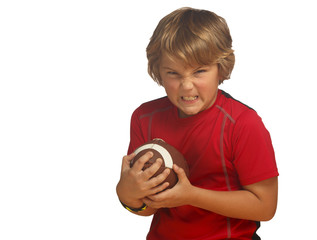 Determined boy in red holding football, isolated over white