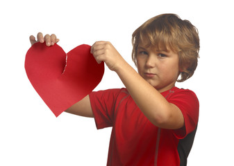 Young boy in red holding a broken paper heart