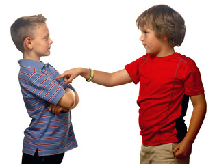 Two young boys bullying and picking on kid, isolated on white.