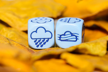 weather of autumn shown on dice weather