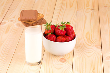 Fresh strawberry and milk in a glass