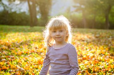 blond girl in autumn park