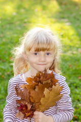 blond girl with autumn leaves