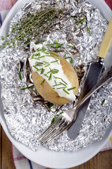 baked potato with creme fraiche and chives