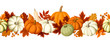 Horizontal seamless background with pumpkins and autumn leaves. - 71788963