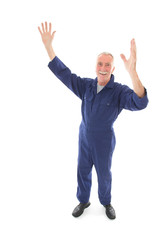 man in blue overall cheering