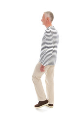Senior man walking isolated over white background