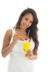 Black woman eating fruit sorbet in glass