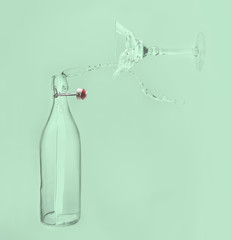 Clear water pour horizontal out of bottle splash into glass with