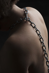 Nude submissive chained woman, bondage act