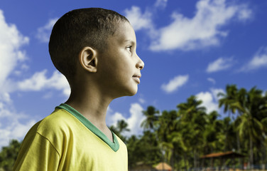 Brazilian boy at tropical background