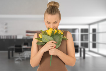 young woman with a bouquet of yellow flowers