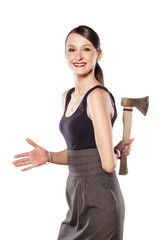 young beautiful woman offers the hand with an ax behind her back