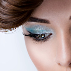 Woman's eye with blue eye makeup