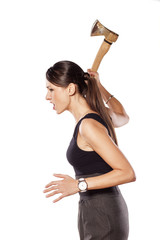 furious young woman swinging an ax