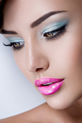 Face of young  girl with vivid blue color eye makeup of eyelid