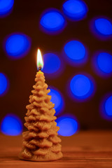 Christmas tree  candle with blur background