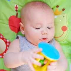 Baby play with bright toy