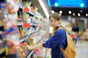 Young woman at supermarket