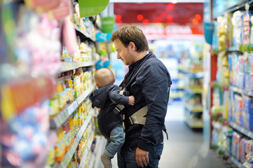 Father and his son at supermarket