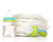 New born child stack of diapers nipple soother baby feeding milk