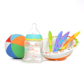 New born infant child composition baby spoons in plate