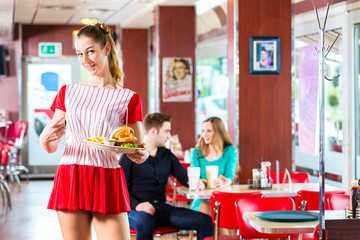 People in American diner or restaurant eating fast food