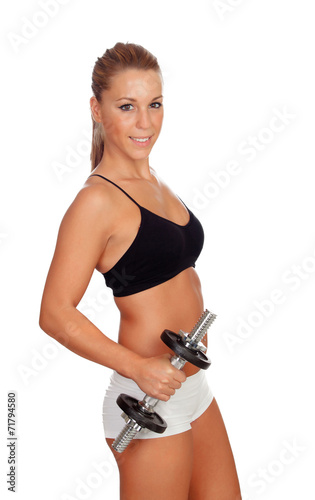 canvas print picture Attractive girl training with dumbbells
