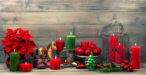 christmas decorations with red candles, flower poinsettia, stars