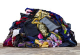 Isolated pile of fabric pieces from a variety of sewing repairs. poster
