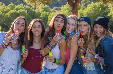 group of kids blowing bubbles