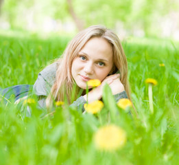 portrait beautiful girl lying on the grass