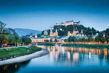 Salzburg cityscape with Salzach river at blue hour, Austria