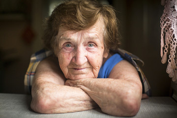 Expressive portrait of an elderly woman.