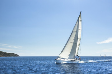 Boat in sailing regatta in open Sea.