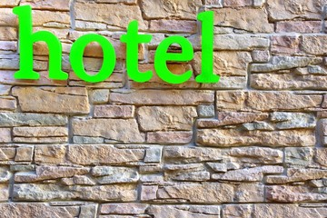 Hotel Sign on Stone Tiled Wall