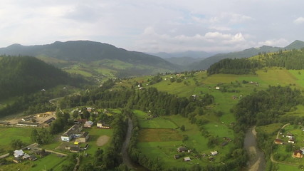 Mountain landscape withe village and  wood. Aerial  shot
