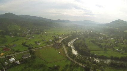Mountain landscape withe village and  river Aerial  shot