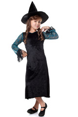 Elegant little girl posing dressed as witch