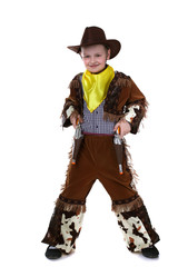 Cheerful little cowboy posing at camera