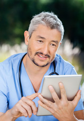 Male Nurse Using Tablet Computer