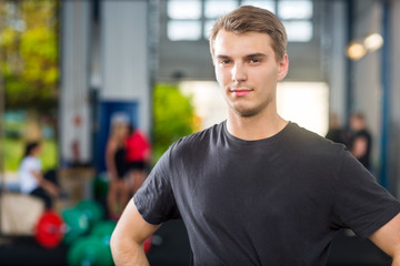 Confident Man Standing At Healthclub