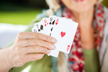 Senior Woman Showing Playing Cards