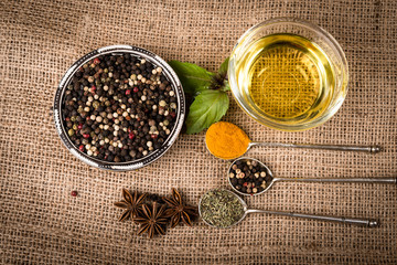 Cooking ingredients, spices, herds and oil on a burlap