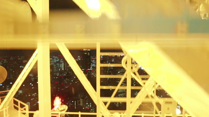 Going down the glass elevator on Tokyo Tower with the city below